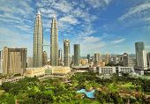 Petronas Twin Towers in Malaysia in Summer Sunny Day. Beautiful Urban View
