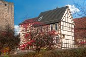 Traditional half-timbered house near an old casle wall, town in Lower Saxony, Germany