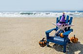 Halloween Background On The Beach With Starfishes In Witchs Hats poster