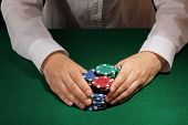 Taking win in poker on green table