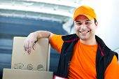 Smiling delivery boy portrait