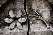 A Carved Flower On A Tomsbstone.