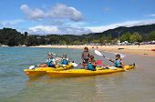 Young People Learning To Kayak At Kaiteriteri Beach, New Zealand
