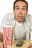 pic of watching movie  - A man looking excited while watching a movie - JPG