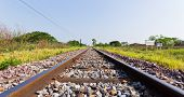 stock photo of long distance  - Long Railways Line Leading to the Distance Destination - JPG