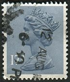 UK-CIRCA 1983:A stamp printed in UK shows image of Elizabeth II is the constitutional monarch of 16 sovereign states known as the Commonwealth realms, in Grey Blue, circa 1983.