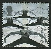 UK - CIRCA 2000: A stamp printed in UK shows image of the Acrobatic Performers (Milennium Dome), cir