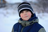 image of frostbite  - young boy with pink cheeks with frostbite in winter - JPG