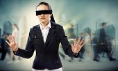 image of blindfolded man  - young blindfolded woman - JPG