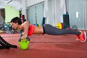 stock photo of kettlebell  - Crossfit fitness woman push ups Kettlebells pushup exercise at gym workout - JPG