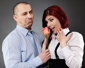 Businessman Giving A Rose To His Partner