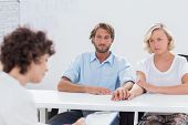 Therapist trying to help a couple to resolve their problem