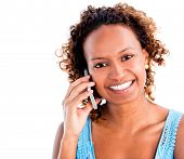 Woman making a phone call on her mobile - isolated over a white background