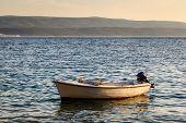 Lonely Boat And Island Brac At Sunset, Dalmatia, Croatia