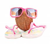 beach travel concept with coconut and beachwear isolated on white background