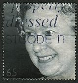 UK-CIRCA 2002: A stamp printed in UK shows image of Elizabeth II is the constitutional monarch of 16 sovereign states known as the Commonwealth realms, Golden Jubilee, circa 2002.