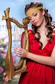 stock photo of tunic  - cute girl in a red tunic with a harp on a background of Greece - JPG