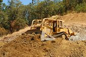 pic of dozer  - Large Bulldozer working a rock hill on a new business project in Roseburg Oregon - JPG