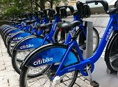 NEW YORK - MAY 24: Bicycles are shown docked at a Citibike sharing kiosk at Bowling Green Station on