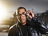image of rapper  - cool urban african american man  posing with gold sunlight - JPG