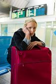 businesswoman waiting for their departure at the airport. symbolic photo for waiting times, flight c