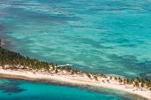 pic of land-mass  - aerial view of the barrier reef of the coast of San Pedro Belize with small land masses or caves - JPG