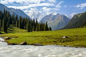 Snowy mountains peak and Karakol river