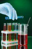 Laboratory glassware on dark color background