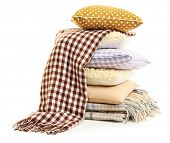 Hill colorful pillows and plaids isolated on white
