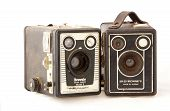 Two Isolated Vintage  Kodak Cameras On White Background