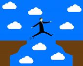 Businessman Jumping Over The Precipice