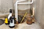 stock photo of suction  - Replacing the old sump pump in a basement with a new one to drain the collected ground water from the sump or pit - JPG