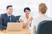 picture of half-dressed  - Recruiters checking the candidate during a job interview at office - JPG