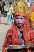 Boy dressed as Lord Krishna attends the Pushkar cattle fair ,Rajasthan,India