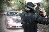 pic of m4  - Warrior with the M4 rifle is stopping the car on the roadblock - JPG