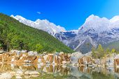 picture of jade  - A view of a river and Jade Dragon Snow Mountain in Lijiang  - JPG