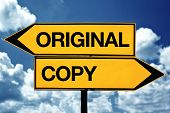 stock photo of plagiarism  - original or copy title on opposite direction street sign - JPG