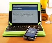 BOISE, IDAHO - DECEMBER 21, 2013: Checking Facebook is easy with mobile apps for tablets and cell ph
