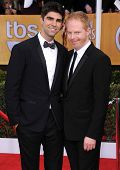 LOS ANGELES - JAN 27:  Jesse Tyler Ferguson & Justin Mikita arrives to the SAG Awards 2013  on Janua