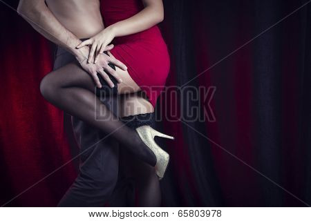 Sexy loving couple embrace. poster