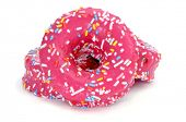 a pile of donuts coated with a pink frosting and sprinkles of different colors on a white background