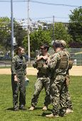 Unidentified US Navy s from EOD team and unidentified helicopter pilot during Fleet Week 2014