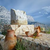 foto of chalice antique  - ancient architecture background with antique coins and column - JPG