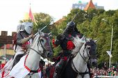 Riga, Latvia - August 21: Two Members Of The Devils Horsemen Stunt Team Fighting With Swords During