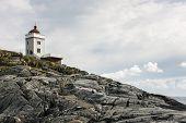 Lighthouse on a rocky cliff