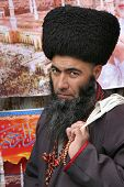 ASHGABAT, TURKMENISTAN - FEBRUARY 26.  Portrait Of Turkmen Man In Telpek With Bushy Beard.