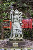 Stone Statue Of A Warrior At A Shinto Shrine In Arashiyama District, Kyoto, Japan
