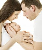 Parents And Baby. Family Mother, Father And Newborn Kid Over White Isolated Background. New Born Chi