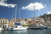 POROS, GREECE - APR 30, 2014: Marina of Poros, is a Greek island in southern part of Saronic Gulf, surface is 31 sq km / 3,780 inhabitants. It is a popular weekend destination for Athenian travellers.