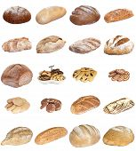 foto of baps  - A selection of freshly baked bread baps and cakes isolated on a white background - JPG